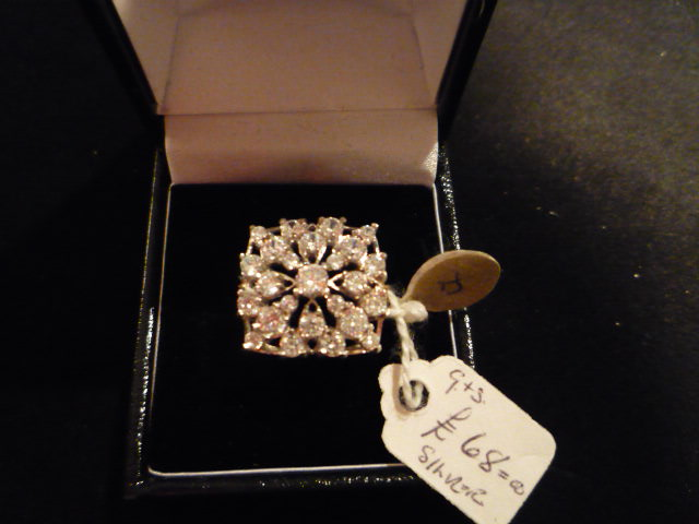 A square set cubic zirconia ring set in silver.